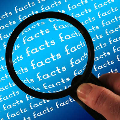 Magnifying glass showing facts